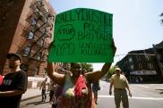Shantel woman holding sign